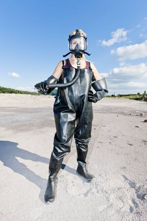 standing woman with gas mask wearing protective clothes Stock Photo - 13679640