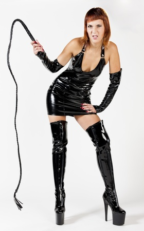 woman wearing extravagant clothes holding a whip photo