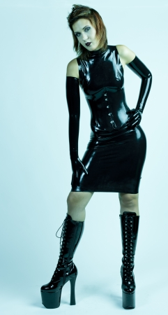 standing woman wearing latex clothes photo
