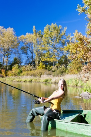 fishing woman sitting on boat Stock Photo - 13679656