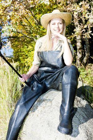 fisher woman sitting on stone Stock Photo - 13679698