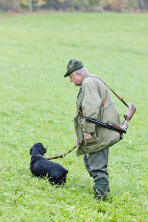 hunter with his dog hunting photo