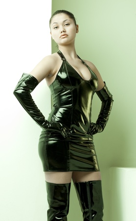 latex woman: portrait of young woman wearing extravagant clothes Stock Photo