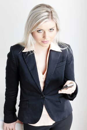 portrait of young businesswoman with a mobile photo