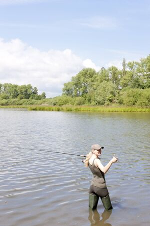 woman fishing in pond Stock Photo - 13680974