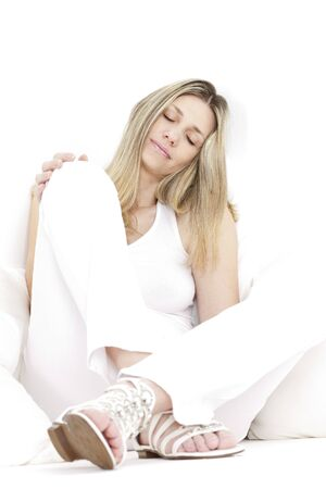 relaxing and sitting woman wearing white clothes and sandals photo