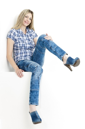 sitting woman wearing jeans and denim clogs Stock Photo - 13680705