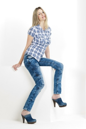 sitting woman wearing jeans and denim clogs Stock Photo - 13680752