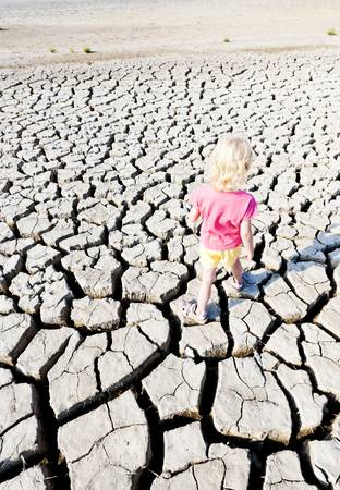 little girl standing on dry land, Parc Regional de Camargue, Provence, France photo