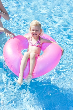 little girl with rubber ring in swimming pool Stock Photo - 13681084