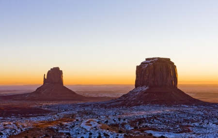 auroral: The Mitten and Merrick Butte during sunrise, Monument Valley National Park, Utah-Arizona, USA Stock Photo