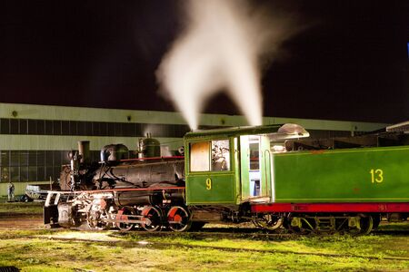 yugoslavia federal republic: steam locomotive in depot at night, Kostolac, Serbia Editorial