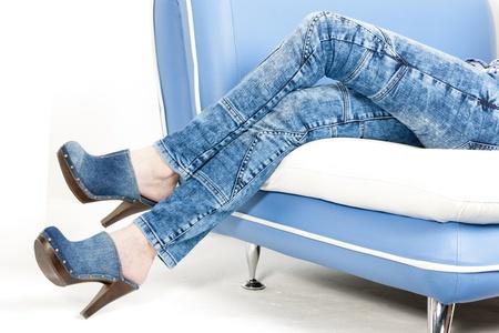 detail of woman wearing denim clogs