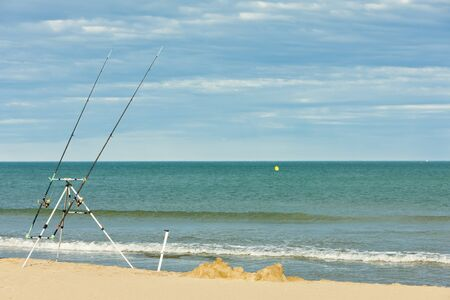 roussillon: fishing rods on the beach in Narbonne Plage, Languedoc-Roussillon, France