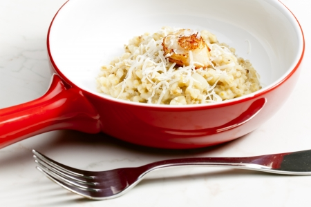 mollusc: fried Saint Jacques mollusc with pearl barley risotto Stock Photo