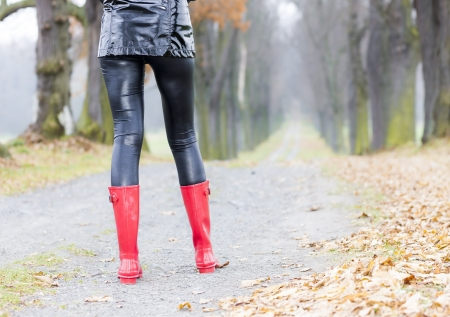 detail of woman wearing red rubber boots photo