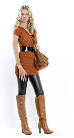 standing woman wearing fashionable brown boots with a handbag Stock Photo - 15466595