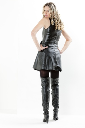 standing woman wearing black dress and black boots Stock Photo - 15466642