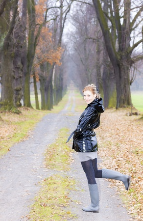 wellingtons: woman wearing rubber boots in autumnal alley