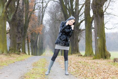 woman wearing rubber boots in autumnal alley Stock Photo - 15466784