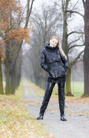 woman wearing black clothes and boots in autumnal alley Stock Photo - 15466698
