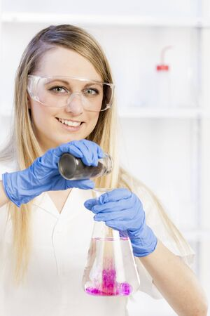 young woman doing experiment in laboratory