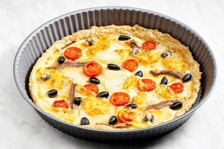 cake with anchovies, cherry tomatoes and black olives photo