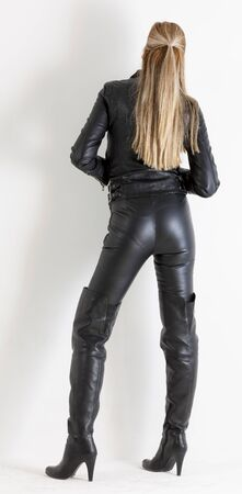 long pants: standing woman wearing black clothes and black boots
