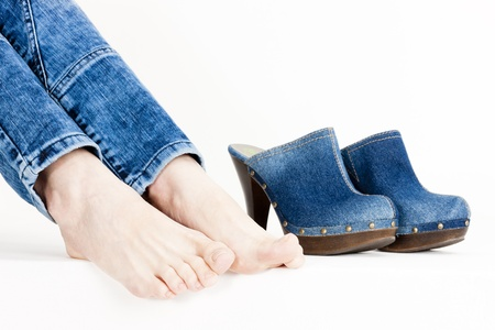detail of woman and denim clogs photo