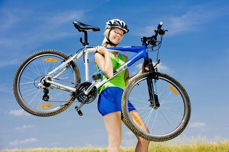 biker carrying her bicycle Stock Photo - 17636612