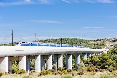 train of TGV on railway viaduct near Vernegues, Provence, France