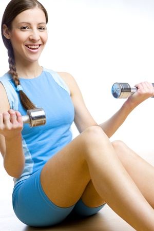 woman with dumb bells at gym photo