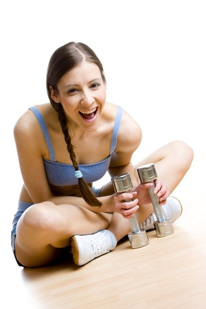 excercise: woman with dumb bells at gym