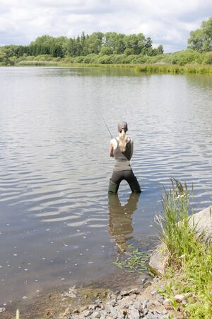 woman fishing in pond Stock Photo - 17717994