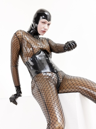portrait of sitting woman wearing latex clothes photo