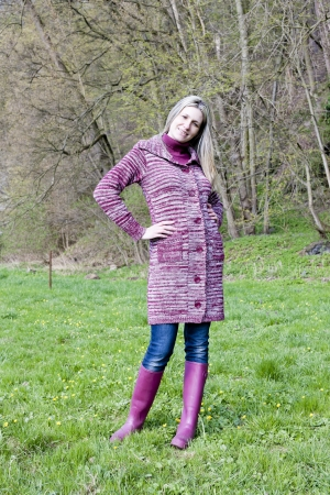 woman wearing rubber boots in spring nature photo