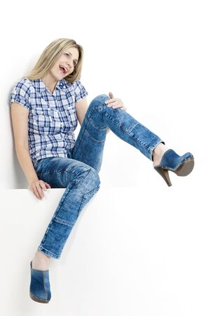 sitting woman wearing jeans and denim clogs Stock Photo - 18604197