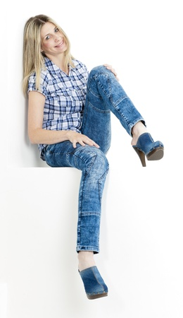 sitting woman wearing jeans and denim clogs Stock Photo - 18604321