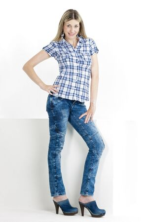 standing woman wearing jeans and denim clogs Stock Photo - 18604403