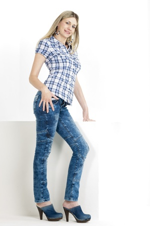 standing woman wearing jeans and denim clogs Stock Photo - 18604217