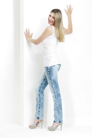 standing woman wearing jeans and summer shoes Stock Photo - 18604202