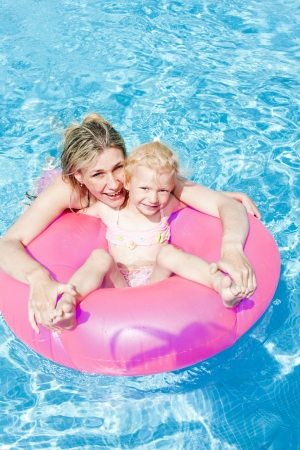 little girl swimsuit: mother with her daughter in swimming pool