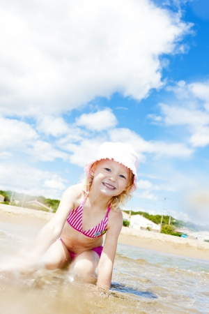 little girl on the beach at sea photo