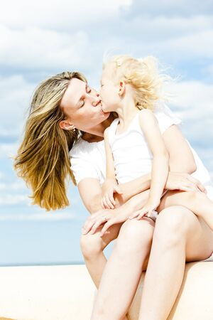 summer portrait of mother with her daughter photo