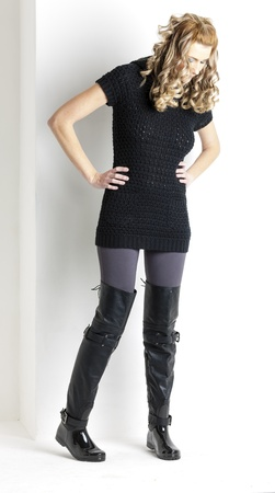 standing woman wearing black clothes and black boots Stock Photo - 18604307