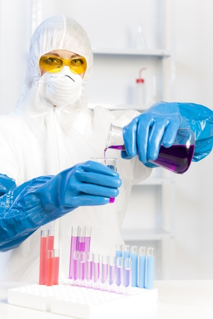 young woman wearing protective coat in laboratory Stock Photo - 18604338
