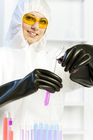 young woman wearing protective coat in laboratory Stock Photo - 18604273