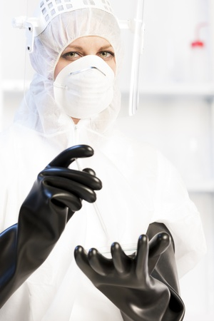 young woman wearing protective clothes in laboratory Stock Photo - 18604288