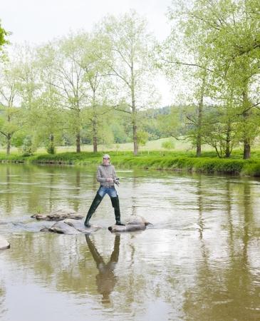 fisherwoman: woman fishing in Sazava river, Czech Republic Stock Photo