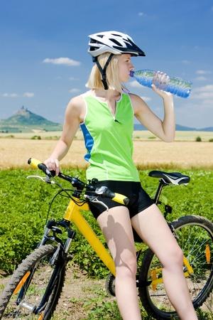 ceske: biker with bottle of water, Hazmburk, Ceske stredohori, Czech Republic Stock Photo